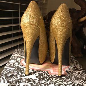 Used gold sparkly Bordello heels